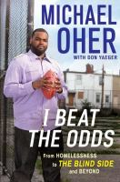 book cover showing micael oher holding a football