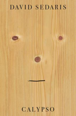 Cover Art features an apathetic smiley face carved into wood.