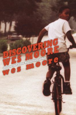Book cover with boy on bicycle looking back over his shoulder