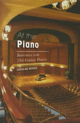Cover of At The Piano with background image of the inside of a keyboard with a piano on a concert stage superimposed in the middle.