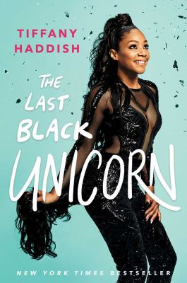 Cover Art features the author wearing an all black outfit, smiling.