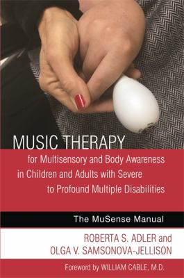 Music Therapy book cover. A hand holding another hand which has an instrument in it.